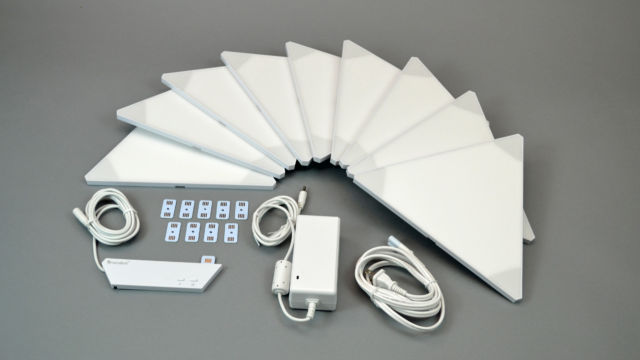 "The Aurora ""Smarter Kit"" includes nine light panels, connectors, the controller unit, and a power supply."