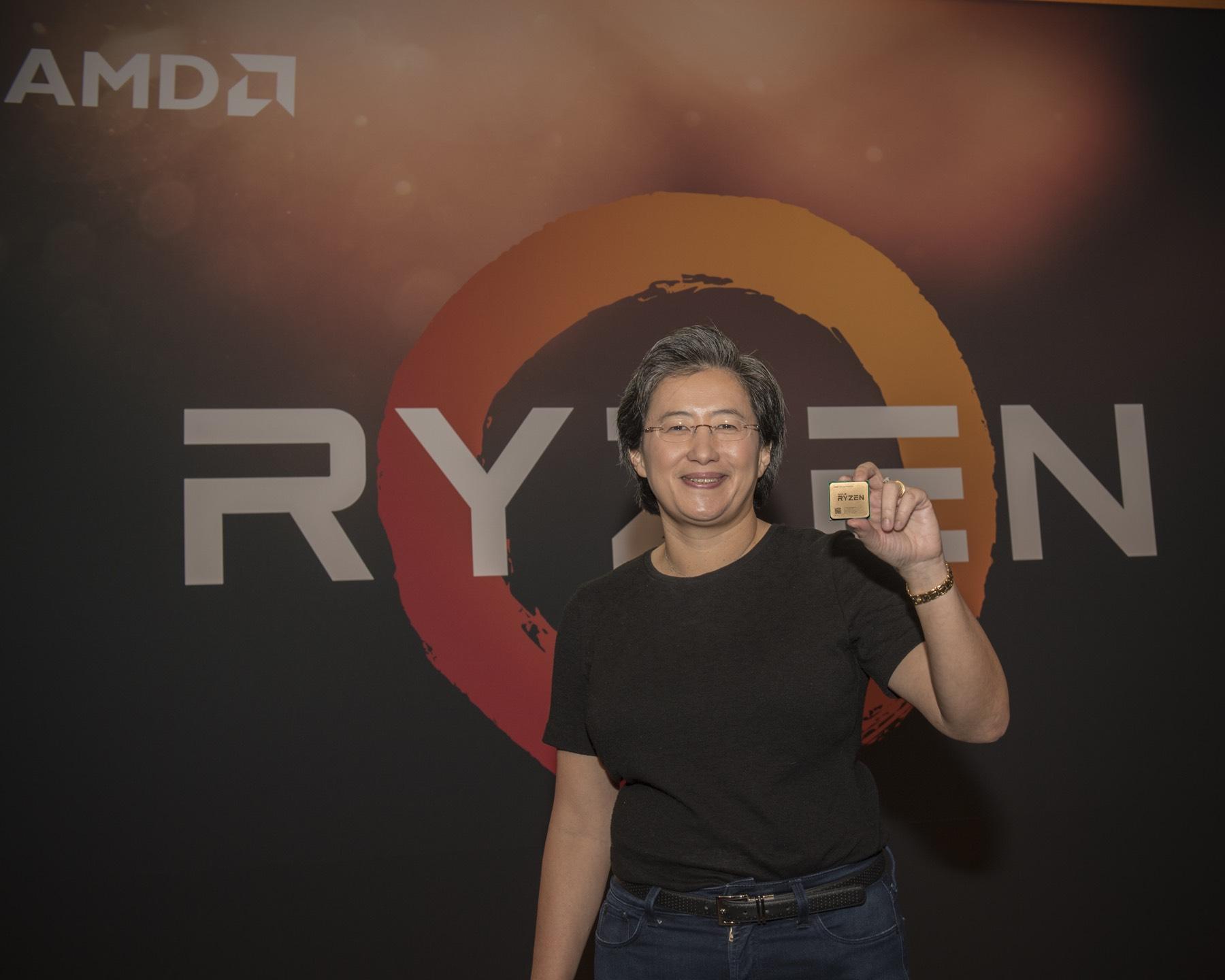 AMD CEO Lisa Su holding a Ryzen chip.