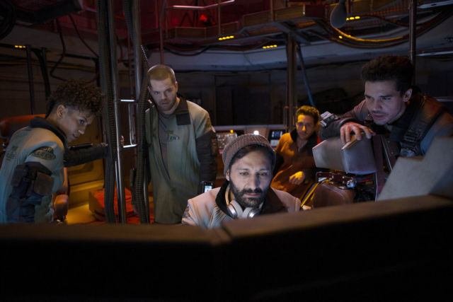 The crew of the Rocinante (before they get the Rocinante) trying to figure out their next move.