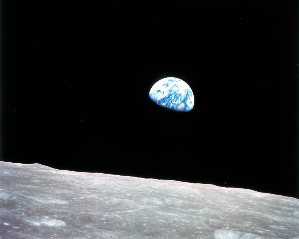 "The iconic ""Earth rise"" image taken during the Apollo 8 mission."