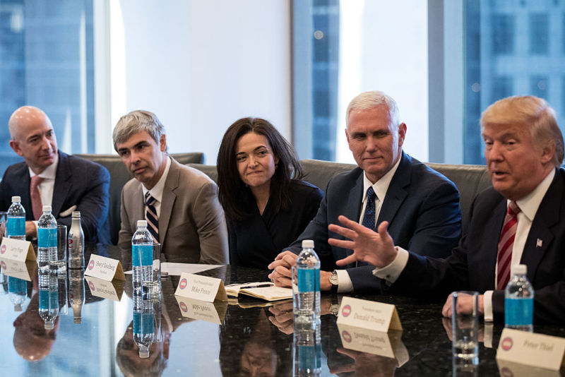 Jeff Bezos, chief executive officer of Amazon (far left), listens during a technology summit with then President-elect Trump in December, 2016.