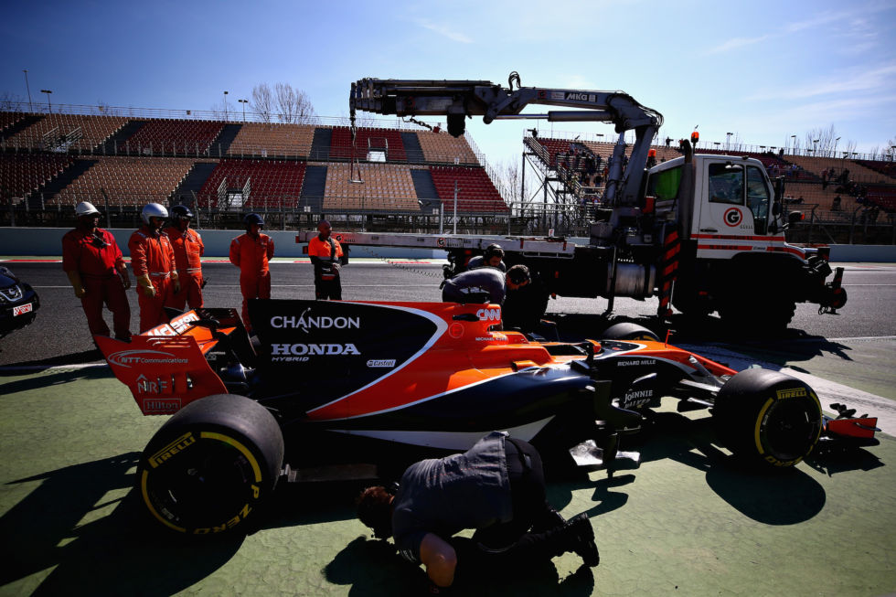 An all too common sight at the preseason tests. Stoffel Vandoorne's McLaren stopped on track, about to be hauled off on the back of a flatbed.