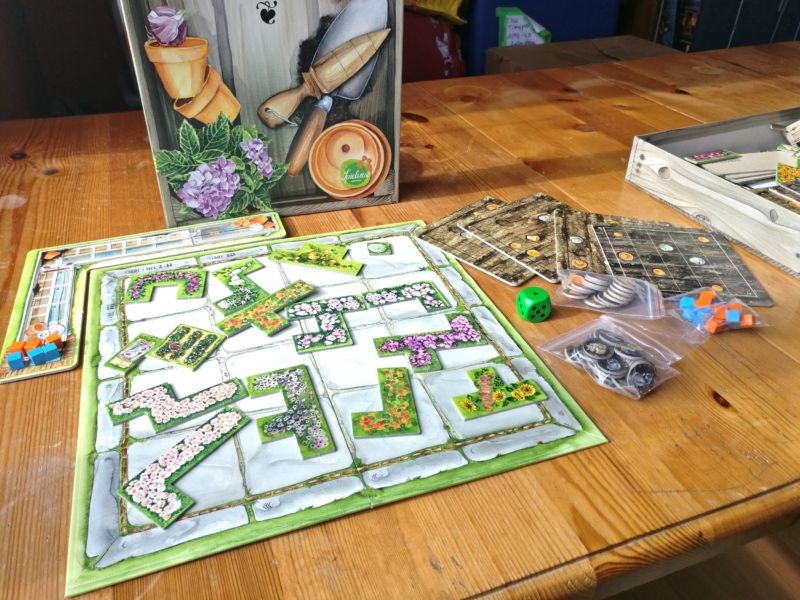 Cottage Garden: Charming artwork, sleeping cats make a gentle game great