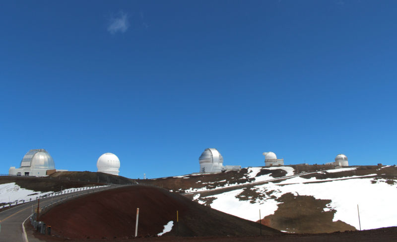On the road, near the summit. There are presently 10 optical telescopes on top of Mauna Kea.