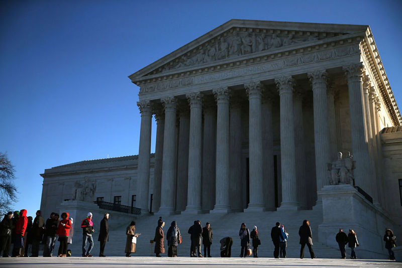 People wait in line to enter the US Supreme Court building in January 2016.