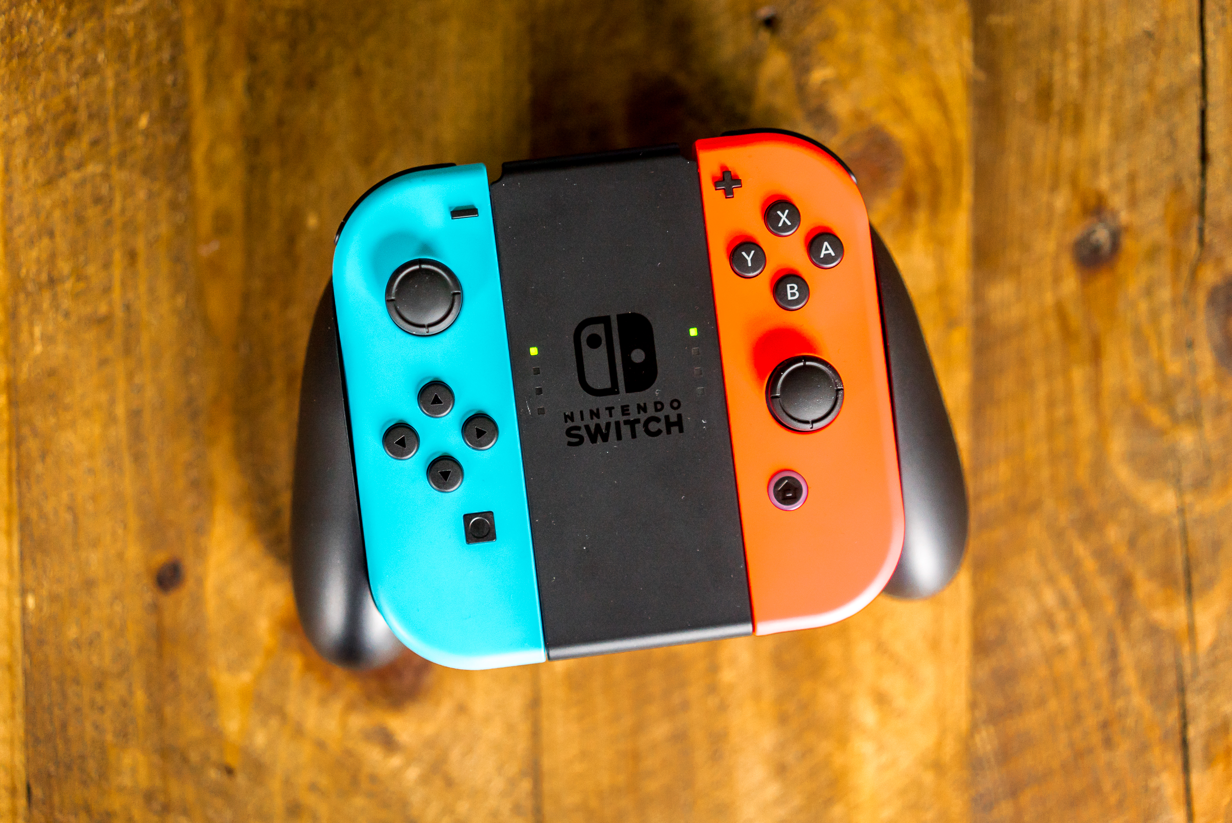 The Switch's Joy-Con controllers in their Grip cradle.