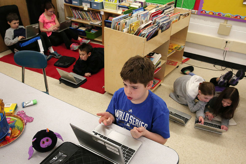 Seth Erdman, center, and his fellow students use Chromebooks while working on a lesson in a third grade class on Friday, January 16, 2015, at Walden Elementary School in Deerfield, Illinois. (Anthony Souffle)