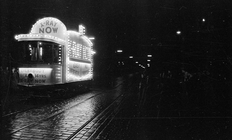 A brightly lit tram in Glasgow encourages people to attend X-rays at the city's hospitals in 1957.