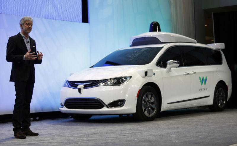 John Krafcik, CEO of Waymo, debuts a customized Chrysler Pacifica Hybrid in January 2017.