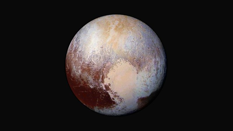 Four images from New Horizons' Long Range Reconnaissance Imager (LORRI) were combined with color data from the spacecraft's Ralph instrument to create this enhanced color global view of Pluto.