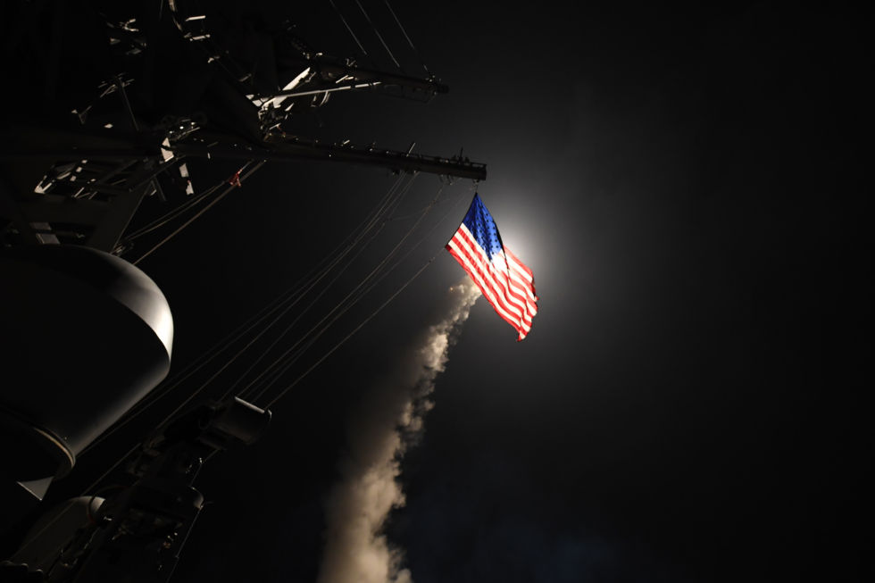 The guided-missile destroyer <em>USS Porter</em> (DDG 78) launches one of a barrage of Tomahawks against a target in Syria while in the Mediterranean Sea, April 7, 2017.