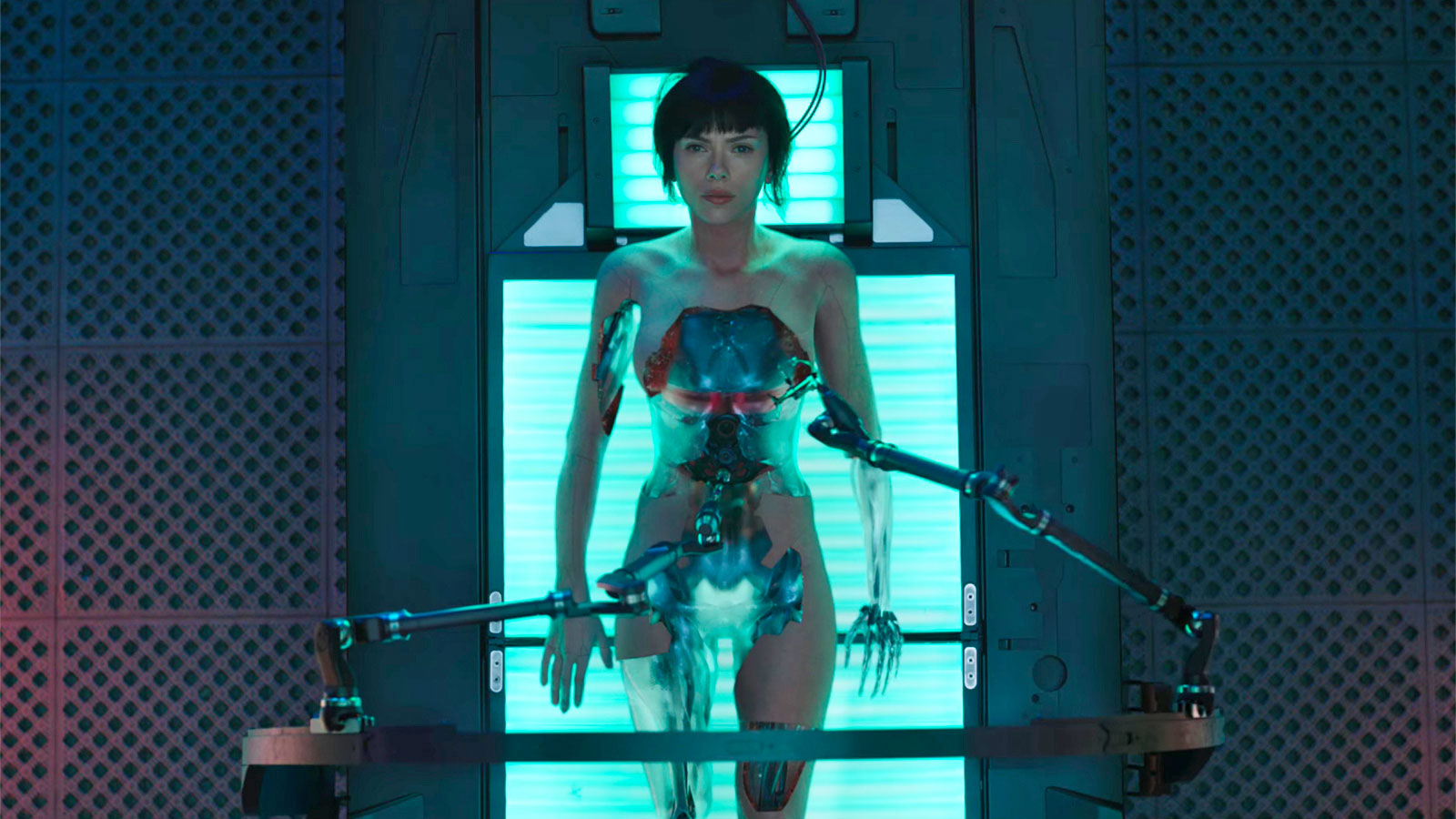 In the live action movie, Mira Killian is a Caucasoid cyborg implanted with the wiped brain of a Japanese woman.