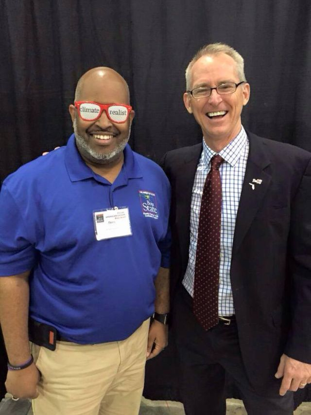 Bob Inglis poses with an event volunteer sporting some RepublicEn sunglasses.