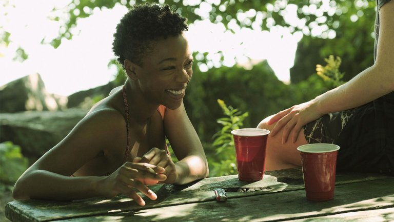 In one of many flashbacks to pre-Gilead America, June's best friend Moira (Samira Wiley) tells June about her latest hookup, with a girl whose name she has accidentally forgotten.