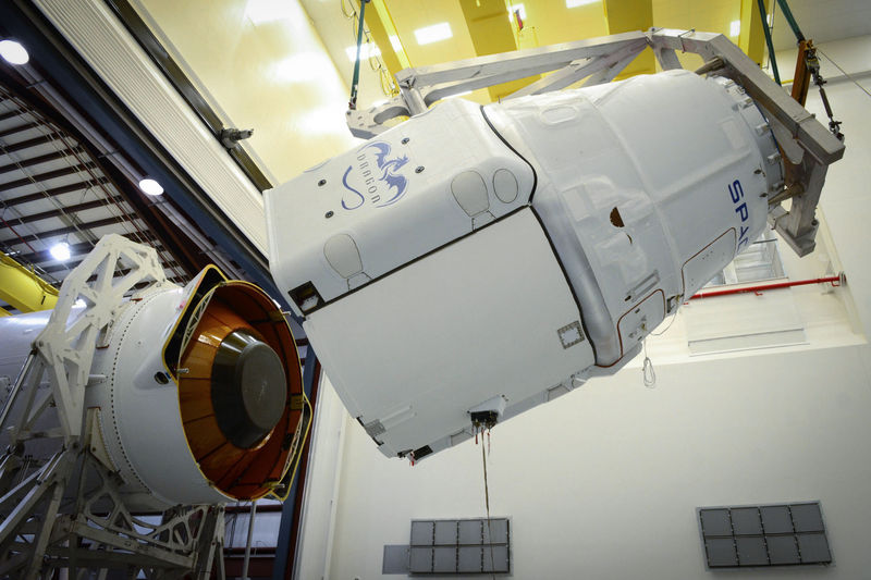 A Dragon spacecraft, with its trunk, is mated to a Falcon 9 rocket in 2014.