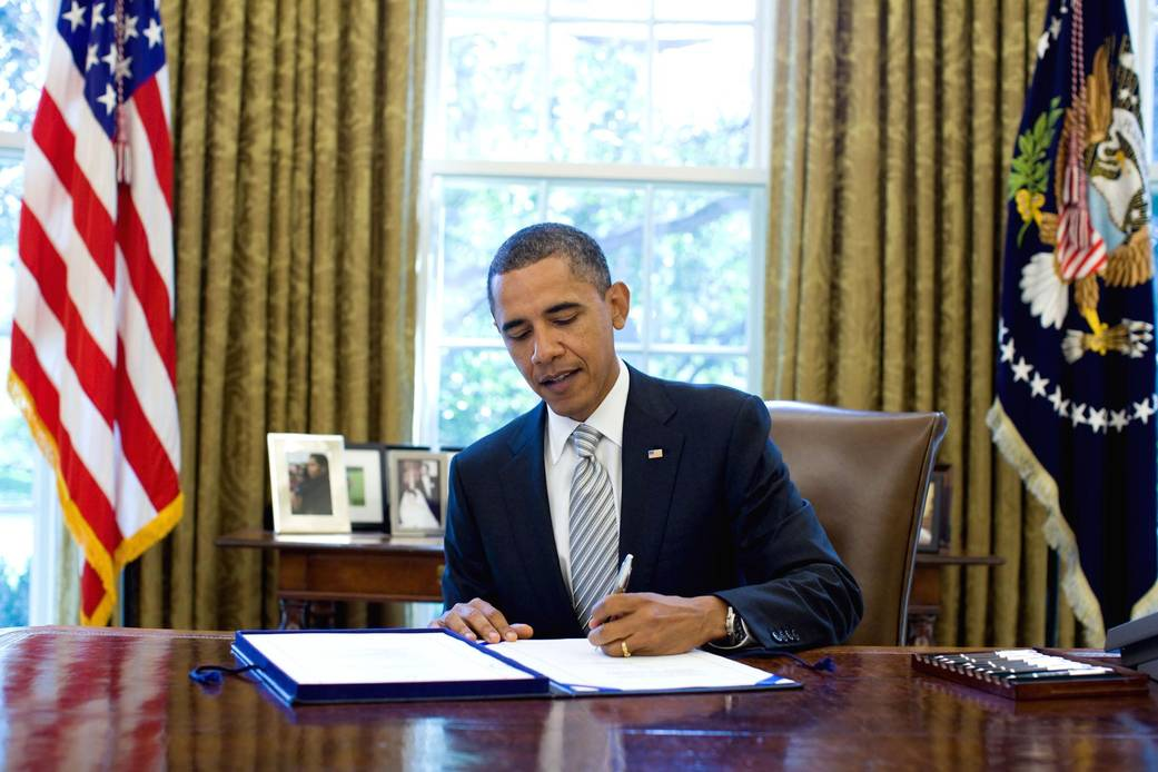 President Barack Obama signs the National Aeronautics and Space Administration Authorization Act of 2010 in the Oval Office, Monday, October 11, 2010.
