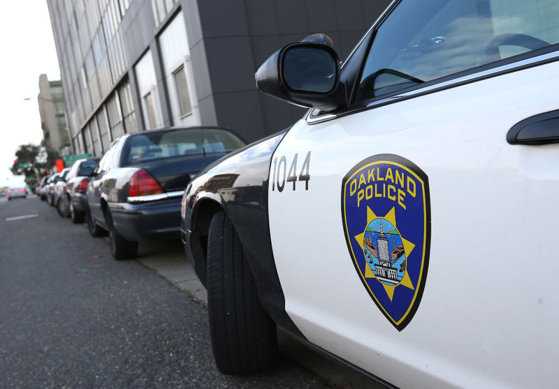 An Oakland Police patrol car sits in front of the Oakland Police headquarters on December 6, 2012.