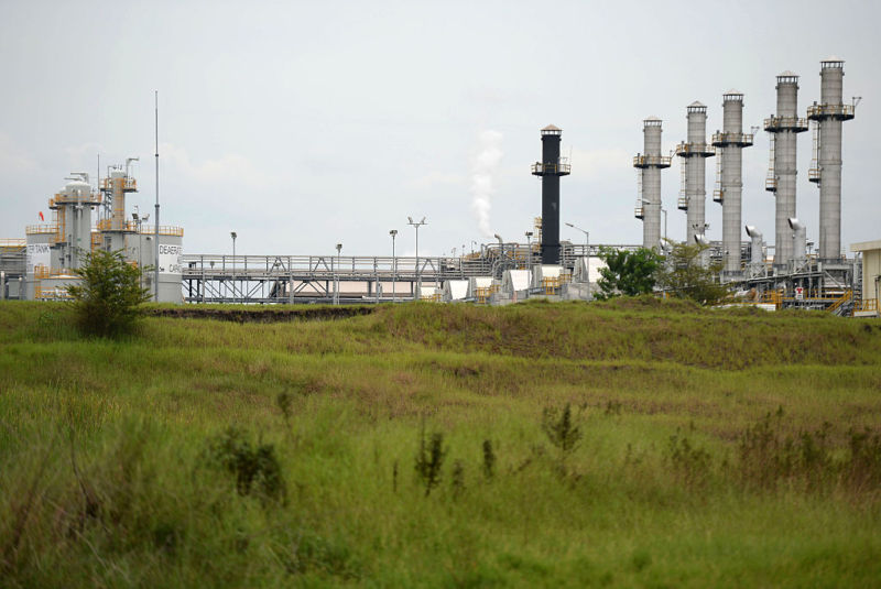 Exxon Mobil oil-processing towers and gas-processing infrastructure.