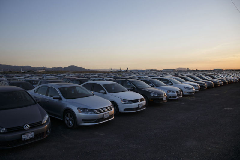 Volkswagen AG Turbocharged Direct Injection (TDI) vehicles sit parked in a storage lot at San Bernardino International Airport (SBD) in San Bernardino, California, U.S., on Wednesday, April 5, 2017. Volkswagen agreed last year to buy back about 500,000 diesels that it rigged to pass US emissions tests if it can't figure out a way to fix them. In the meantime, the company is hauling them to storage lots, such as ones at an abandoned NFL stadium outside Detroit, the Port of Baltimore and a decommissioned Air Force base in California. Photographer: Patrick T. Fallon/Bloomberg via Getty Images