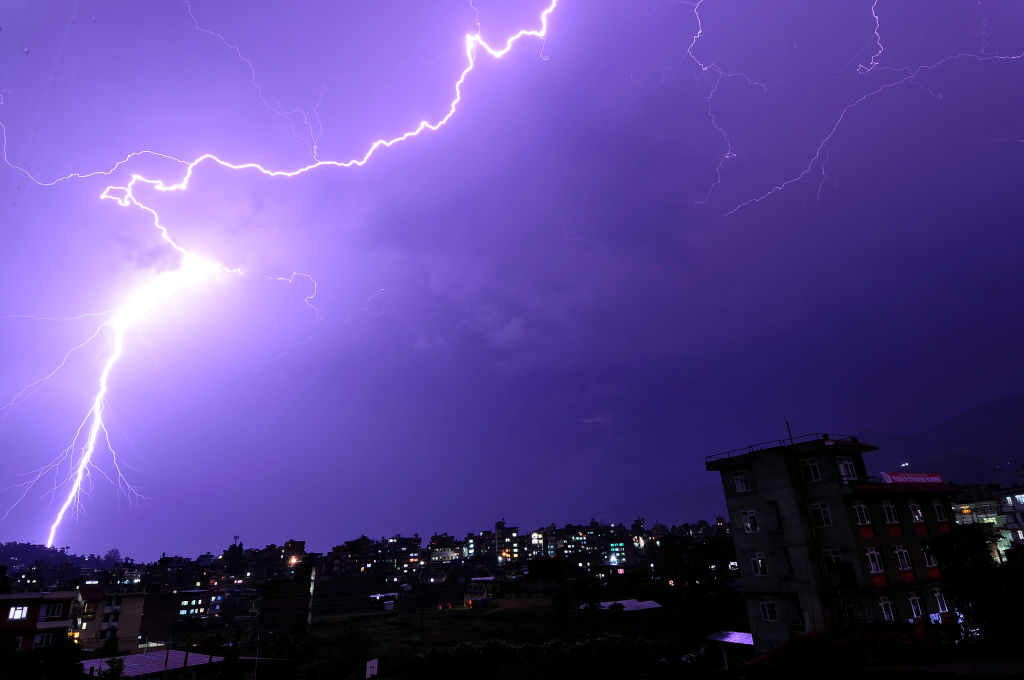 Lightning flashes illuminates the sky over during a thunderstorm over Panga, Kirtipur, Kathmandu, Nepal on Thursday, May 04, 2017.