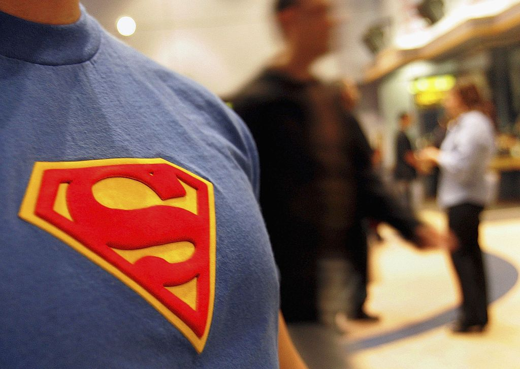 675a03d9a8011 Enlarge   A moviegoer wearing his Superman T-shirt in the lobby prior to  watching the new Superman Returns movie on June 27