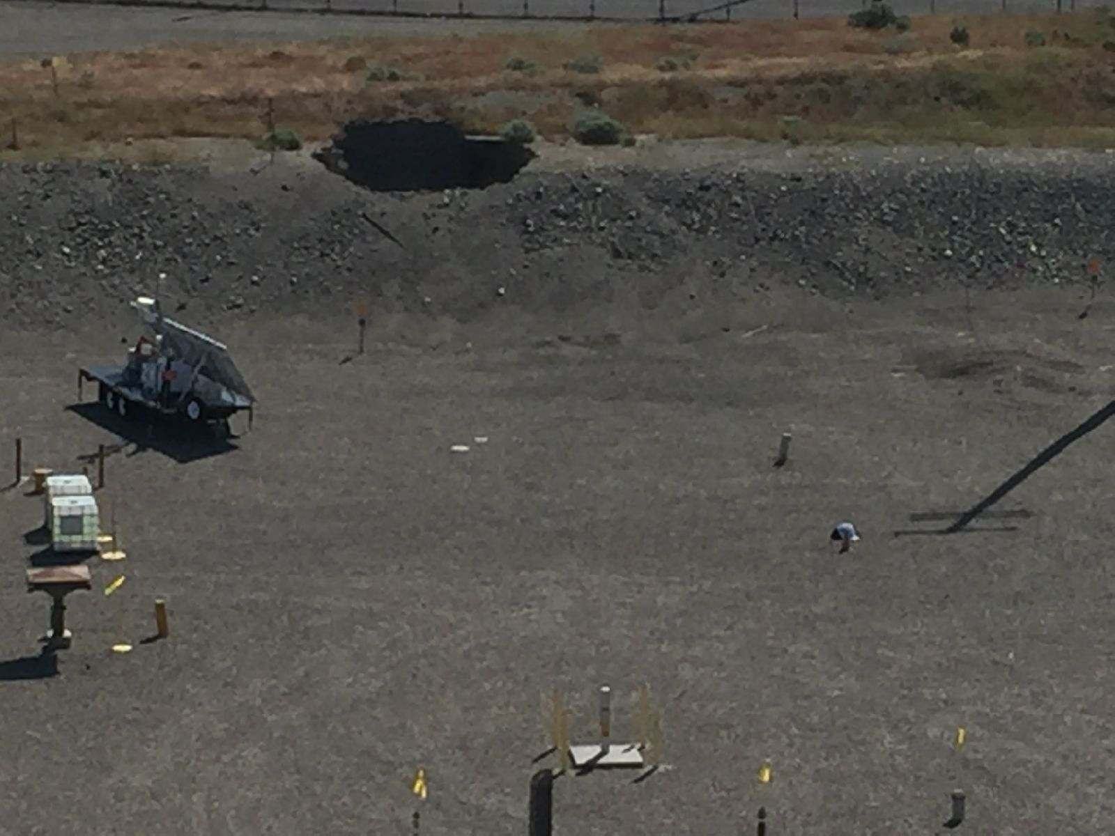 "From Hanford.gov: ""This picture shows a 20-foot by 20-foot hole in the roof of a tunnel that is hundreds of feet long. Surveys of the area show no indication of release of contamination as a result of the cave-in."""