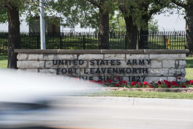 A sign marks the entrance to the US Army facility Fort Leavenworth in Leavenworth, Kansas.