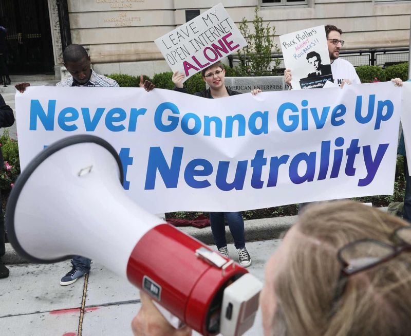 Protestors object to FCC Chairman Ajit Pai's plan to eliminate net neutrality rules before Pai's appearance at the American Enterprise Institute in Washington, DC, on May 5, 2017.