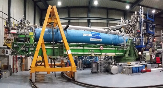 That blue tube contains a magnet similar to the ones used to steer particles around the LHC.