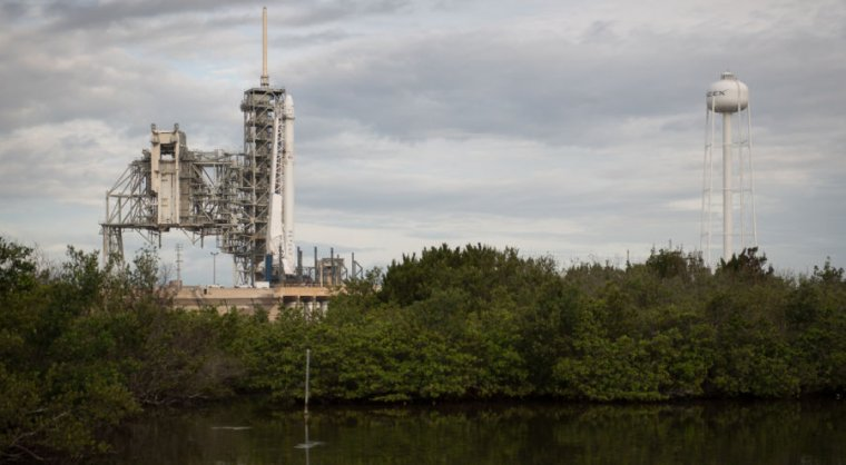 The SpaceX Falcon 9 rocket, with the Dragon spacecraft onboard, is seen at Launch Complex 39A at NASA's Kennedy Space Center on Saturday.