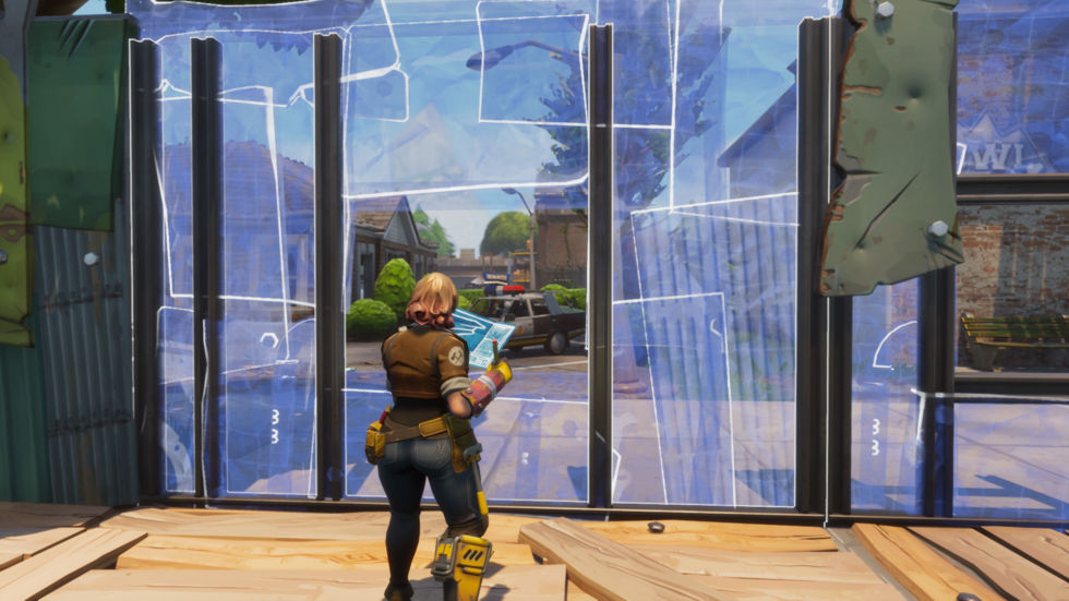 Many of <em>Fortnite</em>'s missions require that you hunker down and protect a valuable object for a certain amount of time. You'll build walls, barriers, and traps by way of this blue-translucent system that maps everything in the game to a large-block grid.