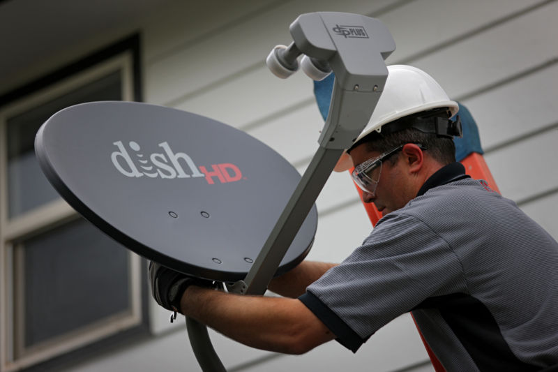 A field service specialist for Dish Network Corp. installs a satellite television system. Photographer: Matthew Staver/Bloomberg via Getty Images