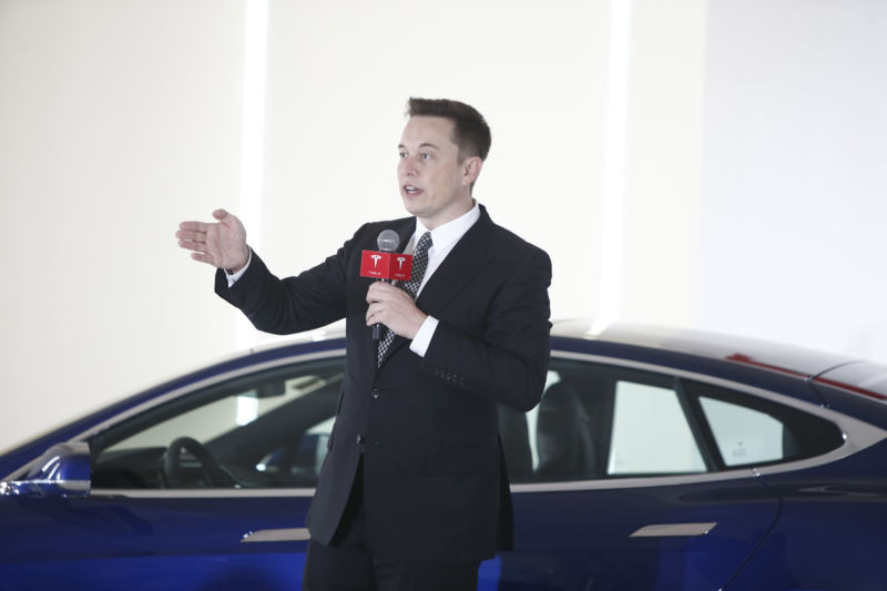 Elon Musk in front of a Tesla in China in 2015. (Photo by VCG/VCG via Getty Images)