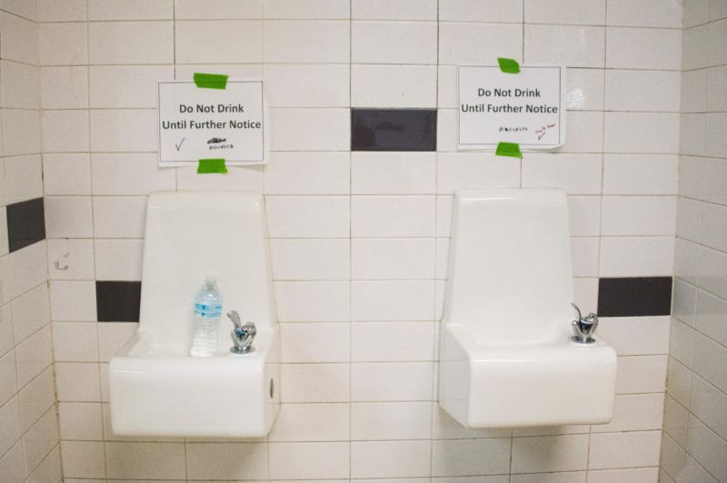 Posters above water fountains warn against drinking the water at Flint Northwestern High School in Flint, Michigan.