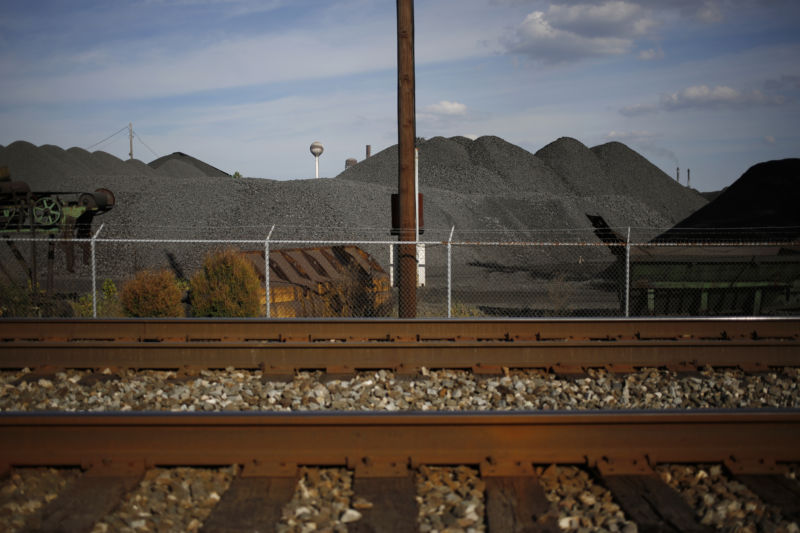 Railroad tracks sit in front of mounds of coking coal piled behind a barbed wire fence at the AK Steel Holding Corp. mill in Middletown, Ohio, US, on Friday, September 23, 2016. Photographer: Luke Sharrett/Bloomberg via Getty Images