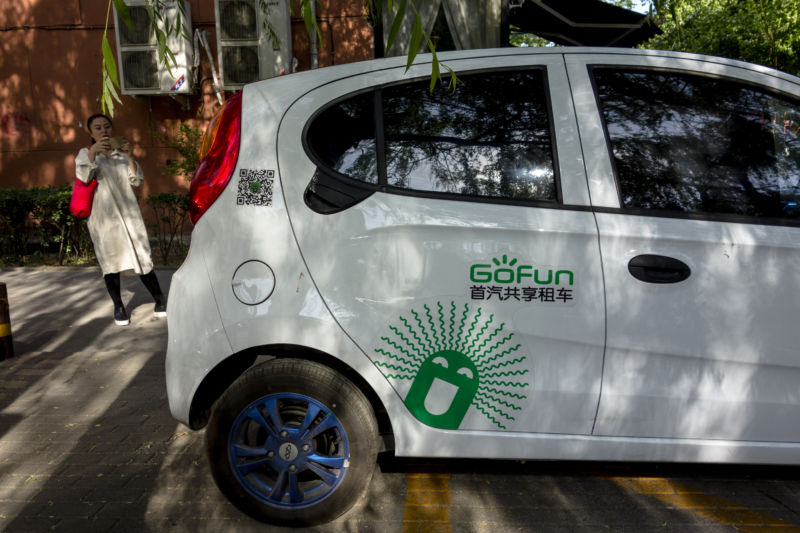 BEIJING, CHINA - GoFun shared e-car parks at roadside. The car-sharing service is an emerging field to draw eyeballs and investment in China. (Photo by Zhang Peng/LightRocket via Getty Images)