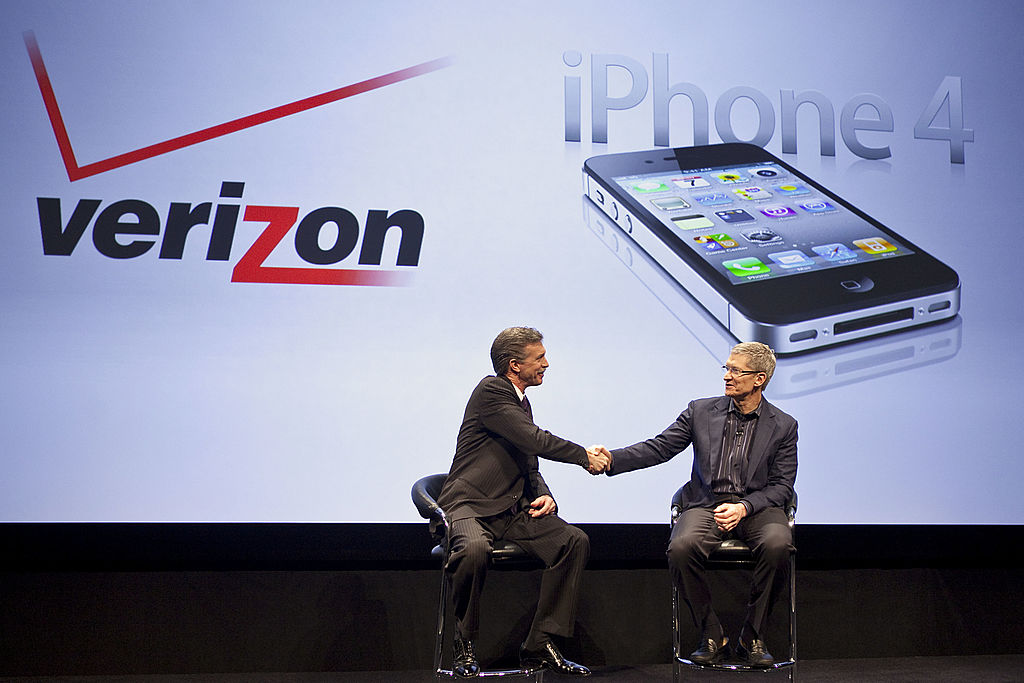 Then-CEO Dan Mead of Verizon Wireless shakes hands with Apple's Tim Cook at the Verizon iPhone announcement in January 2011 in New York.