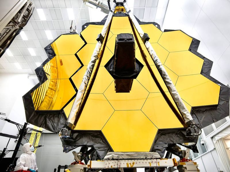 The towering primary mirror of NASA's James Webb Space Telescope stands inside a cleanroom at NASA's Johnson Space Center in Houston.