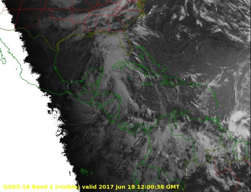 This preliminary and non-operational GOES-16 visible image shows two tropical systems, one near the Gulf of Mexico, and the other northeast of South America.