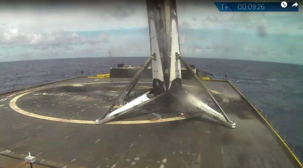A webcast still of the Falcon 9 rocket first stage shortly after landing.