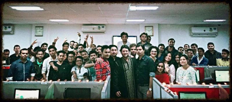 This November 2015 photo appears to be a company photo of Accostings, which <em>Reply All</em> identified as an India-based tech support scam company. Kamal Verma is standing in a black shirt with a watch in the center of the photo.