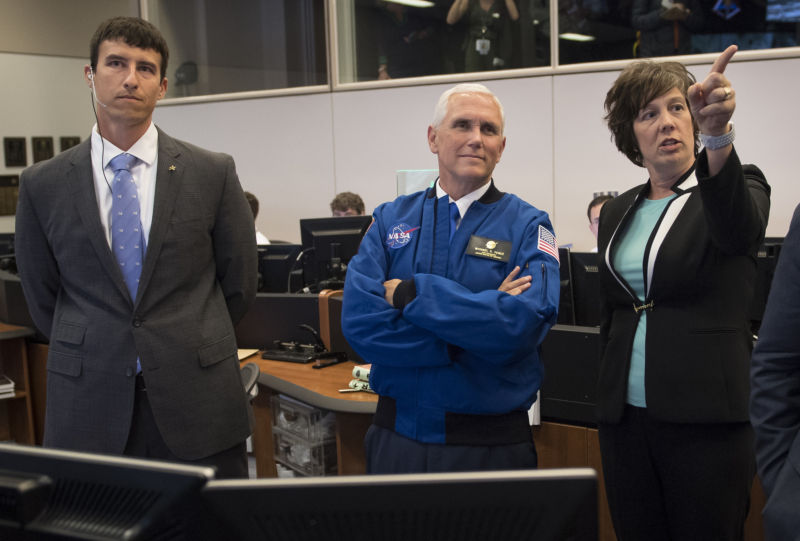 Vice President Mike Pence, center in Mission Control Houston, has overseen all space decisions made by the Trump administration.
