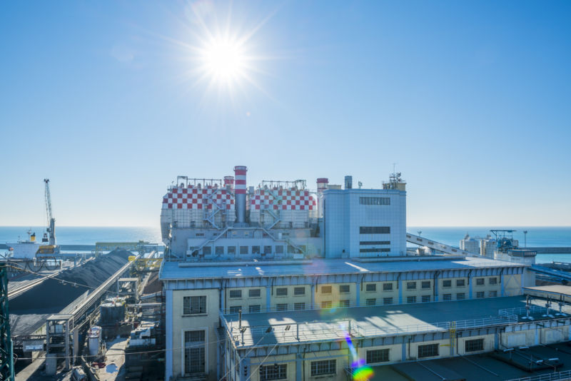 Thermal power plant with sun in Genoa, Italy.