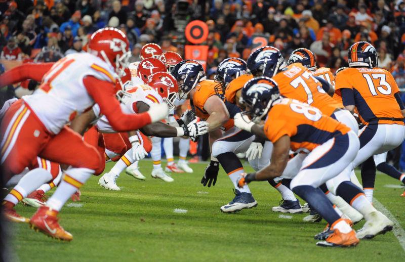 The Denver Broncos' offensive line collides with the Kansas City Chiefs' defense November 27, 2016.
