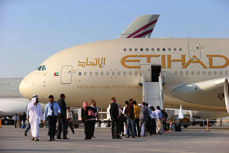 Visitors line up to look at an Etihad Airways Airbus A380-800 at the Dubai Air Show in 2015.