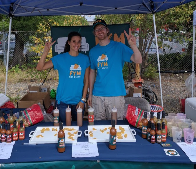 Dane Wilcox and his sister selling FYM hot sauce.