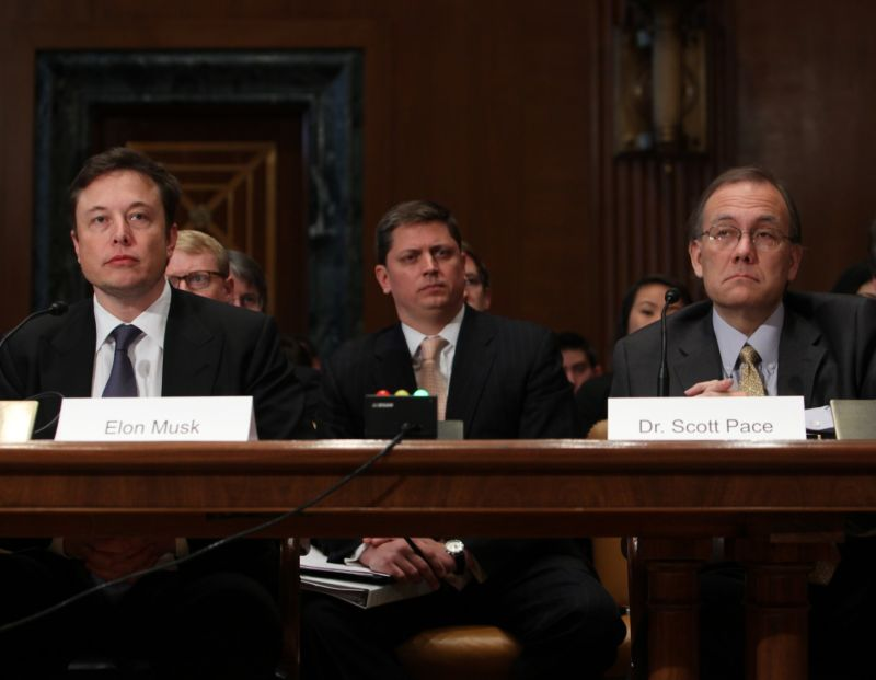 Scott Pace, right, and Elon Musk, left, testify before Congress in 2014.