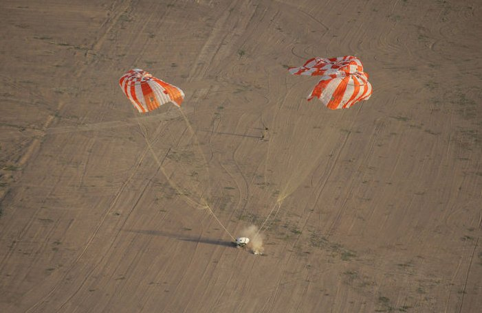 A test model of the Orion spacecraft, with its parachutes, is tested in Arizona.
