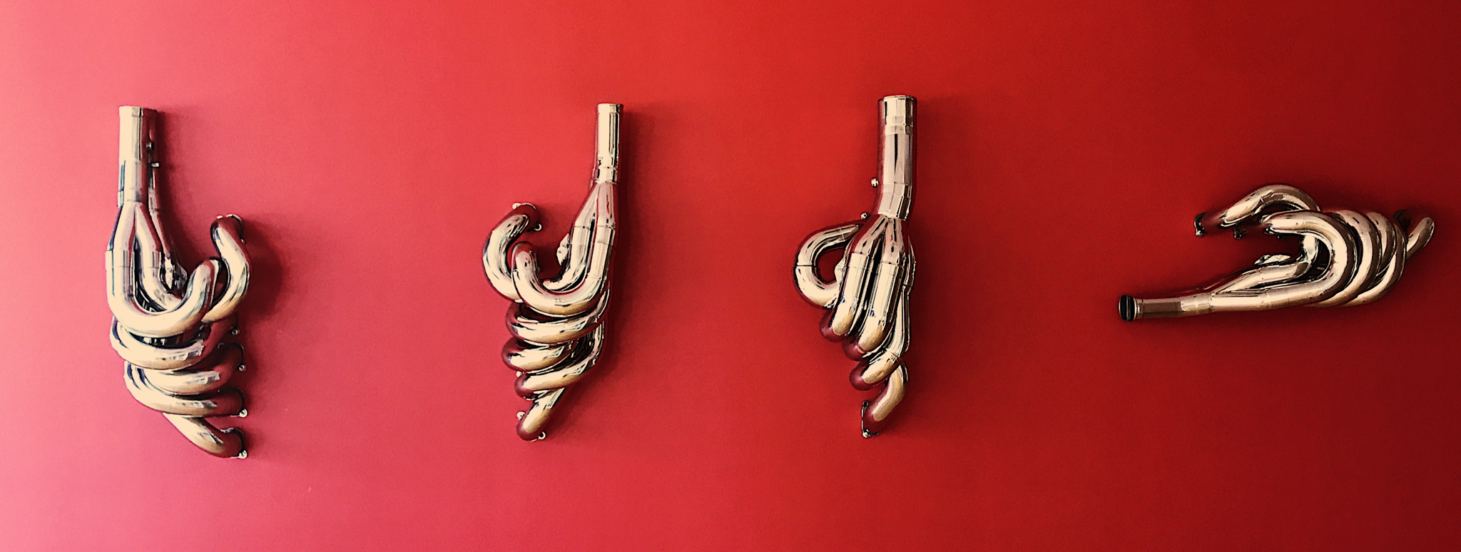 Why have art on your walls when you can have exhaust manifolds?