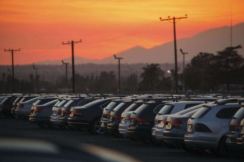 Volkswagen AG Turbocharged Direct Injection (TDI) vehicles sit parked in a storage lot at San Bernardino International Airport (SBD) at dusk in San Bernardino, California, on Wednesday, April 5, 2017. Volkswagen agreed last year to buy back about 500,000 diesels that it rigged to pass US emissions tests if it can't figure out a way to fix them. In the meantime, the company is hauling them to storage lots, such as ones at an abandoned NFL stadium outside Detroit, the Port of Baltimore and a decommissioned Air Force base in California. Photographer: Patrick T. Fallon/Bloomberg via Getty Images